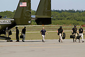 Members of the United States Secret Service walk out of a Marine Corp Osprey in advance of the arrival of U.S. President Barack Obama, at the Martha's Vineyard Airport in West Tisbury, Massachusetts, U.S., on Saturday, August 9, 2014.  The Obama's are vacationing on the island for two weeks.<br /> Credit: Matthew Healey / Pool via CNP