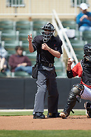 Home plate umpire Jose Lozada makes a strike call during the South Atlantic League game between the Lexington Legends and the Kannapolis Intimidators at Kannapolis Intimidators Stadium on May 15, 2019 in Kannapolis, North Carolina. The Legends defeated the Intimidators 4-2. (Brian Westerholt/Four Seam Images)