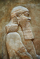 Stone relief sculptured panel of a high dignitary. Facade L. Inv AO 19873-4 from Dur Sharrukin the palace of Assyrian king Sargon II at Khorsabad, 713-706 BC.  Louvre Museum Room 4 , Paris