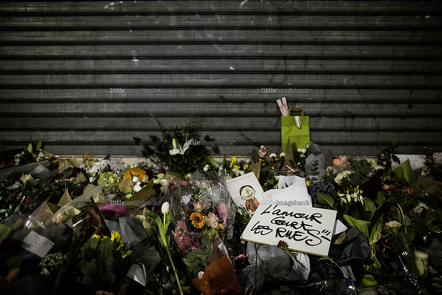 Paris, France, 15.11.2015. Flowers and messages are seen across the street from Le carillon, a bar that was attacked by the terrorists. Images from Paris in the aftermath of the devastating terror attacks on friday november 13. Photo: Christopher Olssøn.