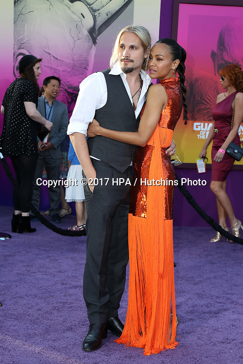 "LOS ANGELES - APR 19:  Marco Perego, Zoe Saldana at the ""Guardians of the Galaxy Vol. 2"" Los Angeles Premiere at the Dolby Theater on April 19, 2017 in Los Angeles, CA"