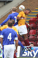 Chris Humphrey and Tony Hibbert challenge in the air in the Motherwell v Everton friendly match at Fir Park, Motherwell on 21.7.12 for Steven Hammell's Testimonial.