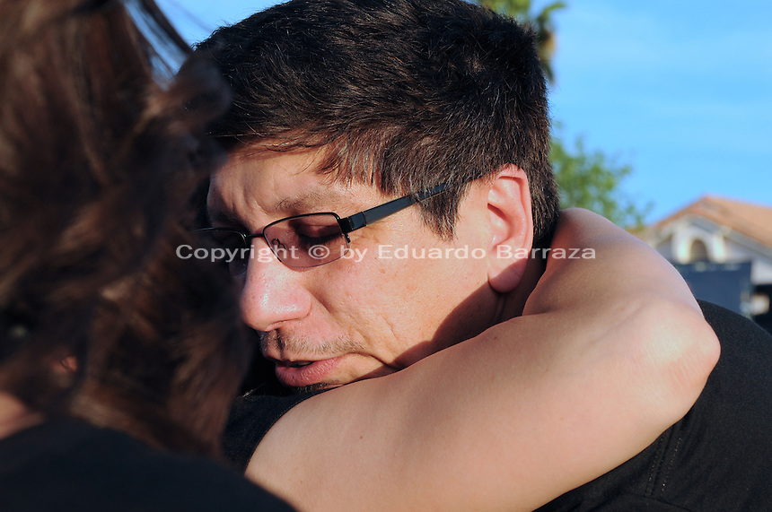 "Gilbert, Arizona – Friends and family of the Mederos Family gathered to hold a memorial for the four victims of the Gilbert Massacre occurred on May 2, 2012. According to Gilbert Police, Lisa Mederos, Amber Mederos, baby Lilly Mederos, and Jim Hiott (Amber's fiancé) were all killed by notorious white supremacist and Neo-Nazi Jason ""J.T."" Ready before taking his own life. In this image, friends and family comfort Hugo Mederos (being hugged). Mederos is the ex-husband of Lisa Mederos, father of Amber Mederos, and grandfather of baby Lilly Mederos is comforted by family and friends at the memorial. He lives in the state of Florida. Photo by Eduardo Barraza © 2012"