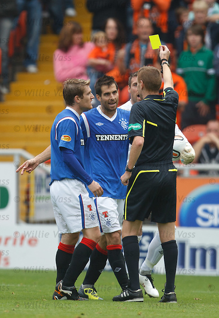 Carlos Bocanegra bookes after a bit of shirt pulling