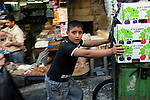 Portrait of Nasser, a 13 year-old Palestinian boy who works in one of the markets in east Jerusalem's old city. July 20, 2008. .Photo by : Tess Scheflan/ JINI
