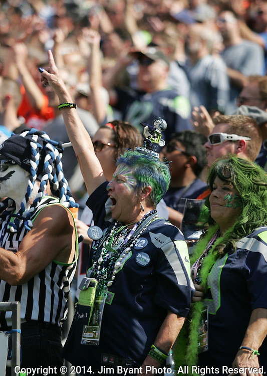 Seattle Seahawks fans cheer during the game against the  Denver Broncos at CenturyLink Field in Seattle, Washington on September 21, 2014. The Seahawks won 26-20 in overtime.    ©2014. Jim Bryant Photo. All rights Reserved.