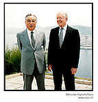 NR00779/ Propaganda portrait of Kim Il Sung, pausing with the former President of the United States Jimmy Carter (June,1994) and used for the annual anniversary of his birth 15 April. Although he deceased in 1994, he remains the President for Life of North Korea. This year North Koreans will celebrate the 10th anniversary of his death.....Portrait de Kim Il Sung, pausant avec l'ancien Président des Etats-Unis Jimmy Carter (juin 1994), utilisé par la propagande pour la celebration annuelle de son anniversaire. Bien qu'il soit decede en 1994, il demeure le President a Vie de la Coree du Nord. Cette annee, les Nord-Coreens celebrerons le 10eme anniversaire de sa mort...Pyongyang, Coree du Nord, archives nord-coreennes...©Nicolas Righetti/Rezo