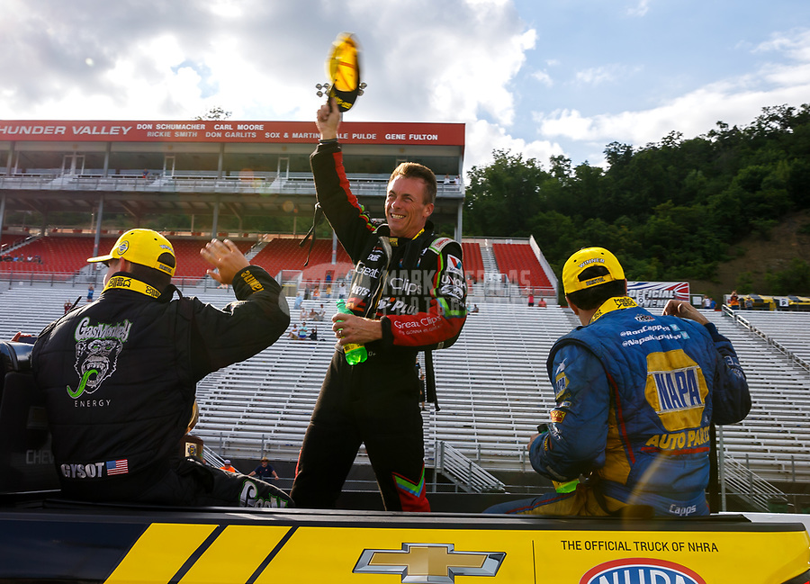 Jun 18, 2017; Bristol, TN, USA; NHRA top fuel driver Clay Millican celebrates after winning the Thunder Valley Nationals at Bristol Dragway. Mandatory Credit: Mark J. Rebilas-USA TODAY Sports