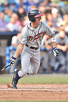 Rome Braves left fielder Stephen Gaylor (15) swings at a pitch during a game against the Asheville Tourists on July 25, 2015 in Asheville, North Carolina. The Braves defeated the Tourists 3-2. (Tony Farlow/Four Seam Images)