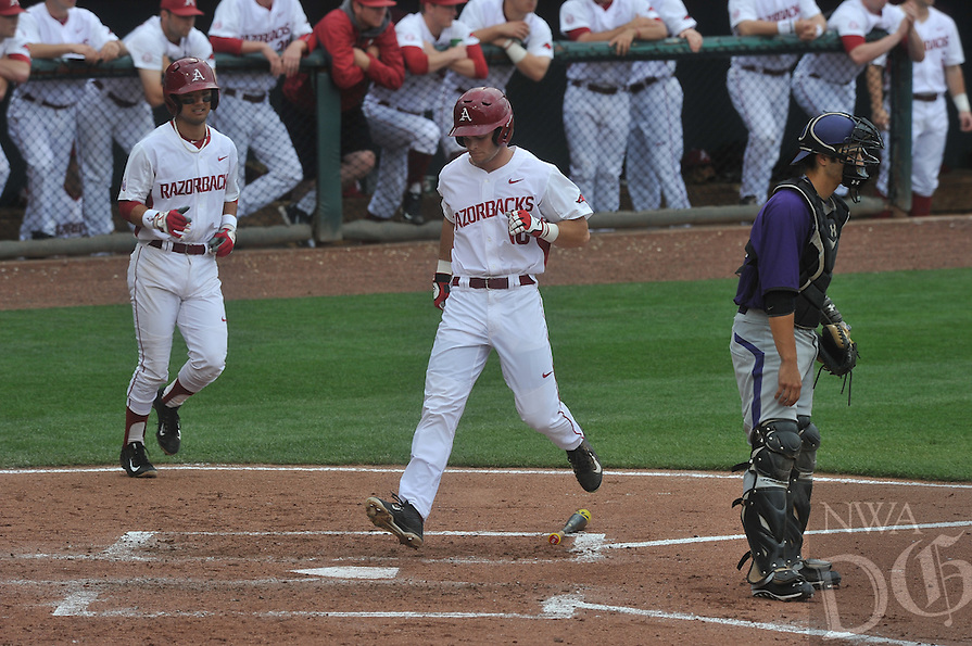 NWA Democrat-Gazette/Michael Woods --04/15/2015--w@NWAMICHAELW...  University of Arkansas baserunner Andrew Benintendi scores a run in the 4th inning of Wednesday nights game against Stephen F Austin at Baum Stadium in Fayetteville.