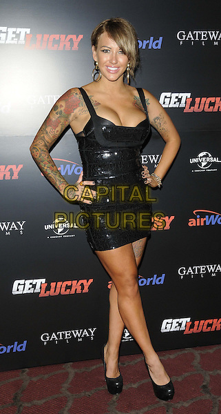 Sallie Axl<br /> attended the &quot;Get Lucky&quot; UK film premiere, The May Fair Hotel, Stratton St., London, England, UK, 4th July 2013.<br /> full length tattoos shiny herve leger dress mini bandage sequined sequin shoes platform hands on hips cleavage <br /> CAP/CAN<br /> &copy;Can Nguyen/Capital Pictures