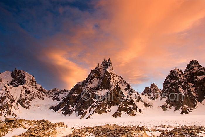 Alpenglow on clouds and mountains at sunset on the Biafo glacier in the Karakoram Himalaya of Pakistan
