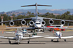 A United States Air Force C-17 Globemaster III sits on the ramp with a variety of general aviation aircraft at Charles M. Schulz Regional Airport in Santa Rosa, California. The Globemaster was there as part of the annual Wings Over the Wine Country Airshow, sponsored by the Pacific Coast Air Museum, in August 2007. The C-17 was first delivered to the Air Force in June of 1993. The Globemaster has a maximum payload capacity of 170,900 pounds. Photographed 08/07