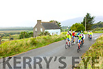 Cyclists salute to the 'Iron Man' as they pass his house on Saturday during the Mike Murphy Memorial Cycle.