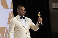 Jordan Peele poses backstage with the Oscar&reg; for original screenplay for work on &ldquo;Get Out&rdquo; during the live ABC Telecast of the 90th Oscars&reg; at the Dolby&reg; Theatre in Hollywood, CA on Sunday, March 4, 2018.<br /> *Editorial Use Only*<br /> CAP/PLF/AMPAS<br /> Supplied by Capital Pictures
