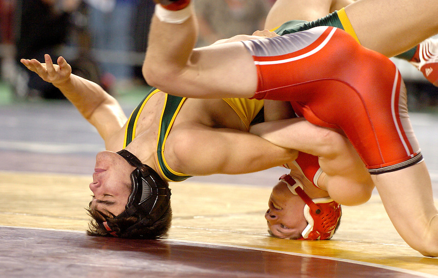 Sehome's Thayne Yazzie and Riverside's Jacob Desroches spin upside down on their heads during a 160-pound 2A match during the first day of the wrestling state championships at the Tacoma Dome on Friday, February 15, 2007.Yazzie lost the match.