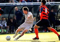 WASHINGTON, DC - NOVEMBER 25, 2012: Andy Riemer (20) of Georgetown University gets a shot past Nick Perea (8) of Syracuse University during an NCAA championship third round match at North Kehoe field, in Georgetown, Washington DC on November 25. Georgetown won 2-1 after overtime and penalty kicks.