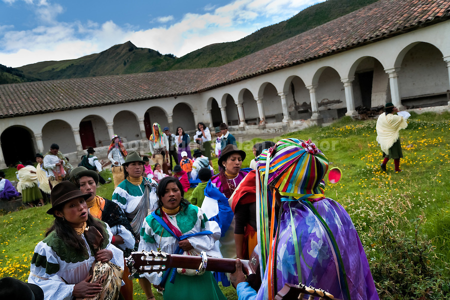 "Indians, wearing colorful costumes, dance and sing in a former monastery garden during the Inti Raymi festival in Pichincha province, Ecuador, 26 June 2010. Inti Raymi, ""Festival of the Sun"" in Quechua language, is an ancient spiritual ceremony held in the Indian regions of the Andes, mainly in Ecuador and Peru. The lively celebration, set by the winter solstice, goes on for various days. The highland Indians, wearing beautiful costumes, dance, drink and sing with no rest. Colorful processions in honor of the God Inti (Sun) pass through the mountain villages giving thanks for the harvest and expressing their deep relation to the Mother Earth (Pachamama)."