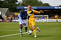 Stephane Pelonde of Gateshead (l) and Chris Holroyd of Cambridge United wrestle for possession during the Blue Square Premier match between Cambridge United and Gateshead at the Abbey Stadium, Cambridge on 29th August, 2009..© Kevin Coleman 2009 ....