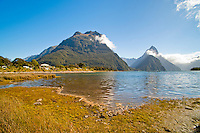 Mitre Peak, Milford Sound, Fiordland, South Island, New Zealand. Mitre Peak is one of the most popular tourist sights at Milford Sound, rising 1692m above the water below.