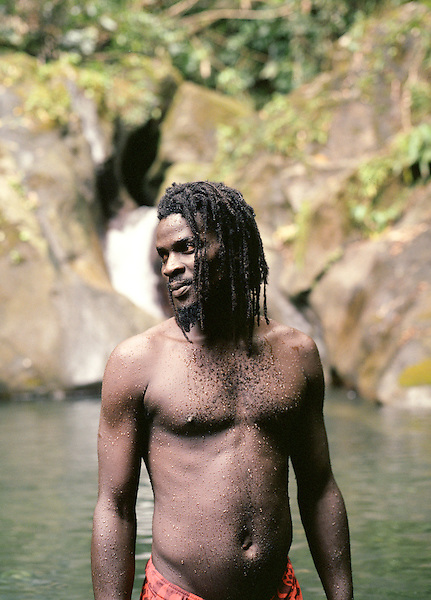 CARIB TERRITORY, DOMINICA  : A local Dominican man swims and dives in the Secret Pool located in the country's Carib Territory. The 3700-acre Carib Territory is home to most of Dominica's 3,000 Carib Indians. Dominica , Eastern Caribbean.