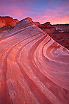 The iconic Fire Wave rock formation at sunset in the Valley of Fire State Park, Nevada, USA