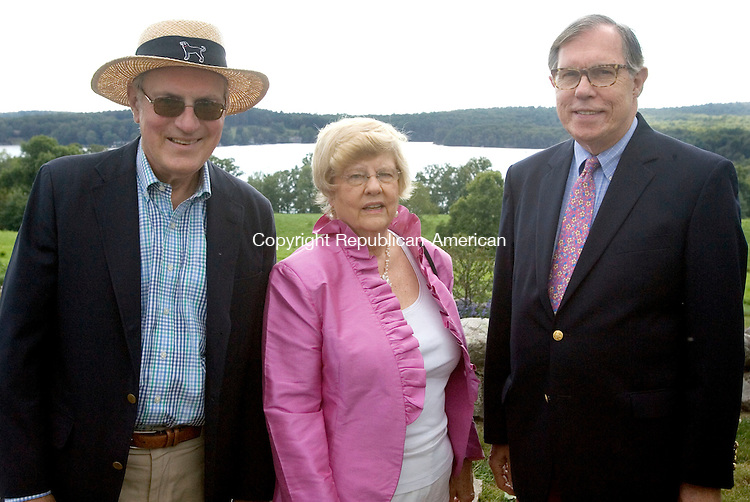 MIDDLEBURY CT. 24 August 2014-082414SV12-From left, Dr. Scott Peterson of Middlebury, Sally and Carter Booth of Woodbury attend a sunset garden party at the Whittemore estate in Middlebury Sunday. The event was for The Mattatuck Museum.<br /> Steven Valenti Republican-American