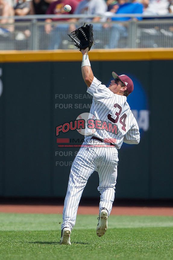 Mississippi State outfielder Hunter Renfroe (34) makes a running catch during Game 11 of the 2013 Men's College World Series against the Oregon State Beavers on June 21, 2013 at TD Ameritrade Park in Omaha, Nebraska. The Bulldogs defeated the Beavers 4-1, to reach the CWS Final and eliminating Oregon State from the tournament. (Andrew Woolley/Four Seam Images)