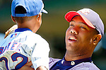 2 July 2005: Livan Hernandez, All-Star pitcher for the Washington Nationals, holds Darren Baker, son of Chicago Cubs' Manager Dusty Baker, prior to a game against the Cubs. The Nationals defeated the Cubbies 4-2 in front of 40,488 at Wrigley Field in Chicago, IL. Mandatory Photo Credit: Ed Wolfstein