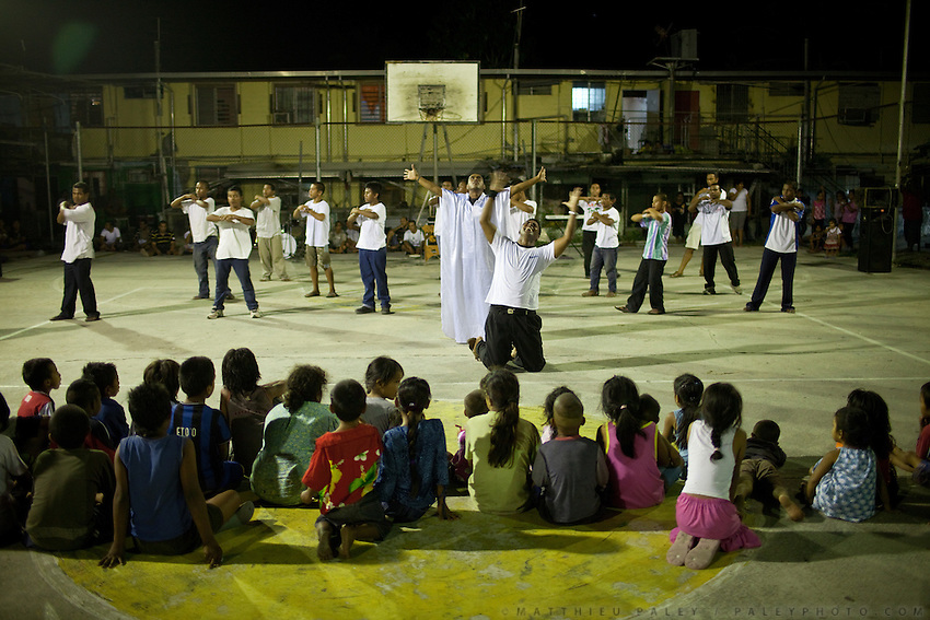 A Saturday night christian show on the baseball court. Nauruans are extremely fervent believers of the Christian faith...Nauru, officially the Republic of Nauru is an island nation in Micronesia in the South Pacific.  Nauru was declared independent in 1968 and it is the world's smallest independent republic, covering just 21square kilometers..Nauru is a phosphate rock island and its economy depends almost entirely on the phosphate deposits that originate from the droppings of sea birds. Following its exploitation it briefly boasted the highest per-capita income enjoyed by any sovereign state in the world during the late 1960s and early 1970s..In the 1990s, when the phosphate reserves were partly exhausted the government resorted to unusual measures. Nauru briefly became a tax haven and illegal money laundering centre. From 2001 to 2008, it accepted aid from the Australian government in exchange for housing a Nauru detention centre, with refugees from various countries including Afghanistan and Iraq..Most necessities are imported on the island..Nauru has parliamentary system of government. It had 17 changes of administration between 1989 and 2003. In December 2007, former weight lifting medallist Marcus Stephen became the President.