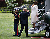 United States President Donald J. Trump salutes the Marine Guard as he and First lady Melania Trump board Marine One to depart the South Lawn of the White House in Washington, DC to deliver remarks at the Prescription Drug Abuse and Heroin Summit in Atlanta, Georgia on April 24, 2019.<br /> Credit: Ron Sachs / CNP