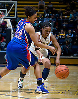 Brittany Boyd of California controls the ball away from Charlicia Harper of Kansas during the game at Haas Pavilion in Berkeley, California on December 21st, 2012.  California defeated Kansas, 88-79.
