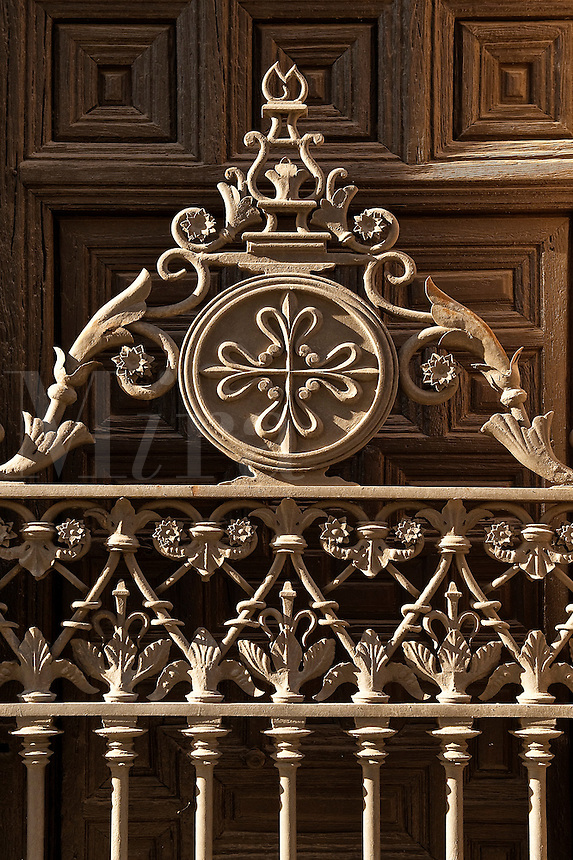 Iron gate and wooden door, Madrid, Spain