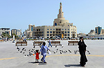 QATAR, Doha, spiral mosque, Fanar, Qatar Islamic Culture Center, muslim qatari woman with asian house maid /  KATAR, Doha, Moschee und FANAR (Qatar Islamic Cultural Center), qatarische Frau mit Kindermaedchen