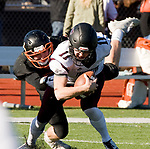 WATERTOWN, CT-112317JS11- Torrington's Ora Curry (11) gets sacked by Watertown's Joseph Deptula (45) during their Thanksgiving Day game Thursday at Watertown High School. <br /> Jim Shannon Republican-American