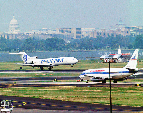 Washington, D.C. - (FILE) -- Flight operations at Ronald Reagan National Airport in Washington, D.C. on Sunday, August 2, 1987 from the Metro subway platform.  The aircraft pictured belong to airlines that are no longer in operation.  The Pan Am aircraft, a Boeing 727, was flown as part of their air shuttle service between Washington and New York.  In 1991, the Pan Am shuttle was acquired by Delta.  The other aircraft pictured was operated by Piedmont Airlines, which was purchased by USAir in 1987.  .Credit: Ron Sachs / CNP
