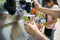 Slurpee lovers take advantage of Free Slurpee Day at a 7-Eleven store in New York on Saturday, July 11, 2015 (7-11, get it?). The 7-Eleven self-proclaimed Free Slurpee Day has been a yearly event for the past 13 years giving away free 7oz Slurpees. The popular icy, slushy, syrupy drinks are available in regular and diet flavors, in combinations, and the stores have stocked up with extra barrels of syrup to meet the expected demand. The 88 year old chain expects to serve over 8 million Slurpees today. (© Richard B. Levine)