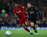 30th October 2019; Anfield, Liverpool, Merseyside, England; English Football League Cup, Carabao Cup, Liverpool versus Arsenal; Joe Gomez of Liverpool and Gabriel Martinelli of Arsenal compete for the ball - Strictly Editorial Use Only. No use with unauthorized audio, video, data, fixture lists, club/league logos or 'live' services. Online in-match use limited to 120 images, no video emulation. No use in betting, games or single club/league/player publications