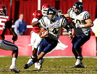 Florida International University Golden Panthers versus the University of Arkansas Razorbacks at Donald W. Reynolds Razorback Stadium, Fayetteville, Arkansas on Saturday, October 27, 2007.  The Razorbacks defeated the Golden Panthers, 58-10...FIU sophomore quarterback Wayne Younger (14) (Cocoa, Fla.) finds daylight in the fourth quarter.