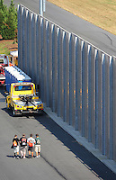 Sept. 17, 2010; Concord, NC, USA; View of the sound wall barrier alongside the track during qualifying for the O'Reilly Auto Parts NHRA Nationals at zMax Dragway. Mandatory Credit: Mark J. Rebilas/