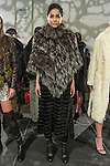 Model Yasminda poses in a knitted silver fox poncho and knit/rabbit fur tunic from the Adrienne Landau Fall Winter 2016 collection, presented on February 17 2016, during New York Fashion Week Fall 2016.