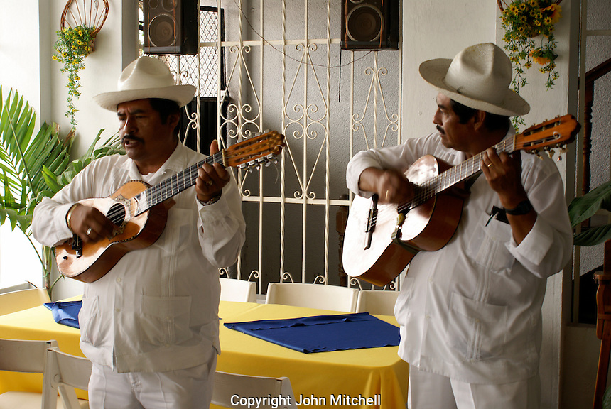 Traditional son jarocho musicians performing in a restaurant in Catemaco, Veracruz, Mexico