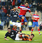 Tam Scobbie and Michael McGovern collide as Rangers defender Carlos Boganegra looks on