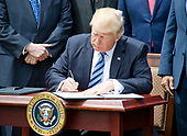 United States President Donald J. Trump signs a Proclamation designating May 4, 2017 as a National Day of Prayer in the Rose Garden of the White House in Washington, DC on Thursday, May 4, 2017.<br /> Credit: Ron Sachs / CNP