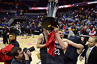 Washington, DC - MAR 11, 2018: Davidson Wildcats forward Peyton Aldridge (23) celebrates with the trophy after winning the Atlantic 10 men's basketball championship between Davidson and Rhode Island at the Capital One Arena in Washington, DC. (Photo by Phil Peters/Media Images International)