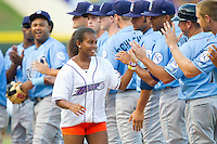 "Jourdan Blair receives high fives from the Wilmington Blue Rocks as she makes her way around the bases on her ""Home Run for Life"" between innings of the Carolina League game against the Winston-Salem Dash at BB&T Ballpark on August 3, 2013 in Winston-Salem, North Carolina.  The Blue Rocks defeated the Dash 4-2.  (Brian Westerholt/Four Seam Images)"