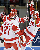 Ryan Ruikka (BU - 2) celebrates his first goal with teammates Sean Escobedo (BU - 21) and Alex Chiasson (BU - 9). - The Boston University Terriers defeated the visiting Providence College Friars 2-1 on Saturday, October 23, 2010, at Agganis Arena in Boston, Massachusetts.