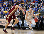 SIOUX FALLS, SD: MARCH 5: Mike Daum #24 from South Dakota State University drive past Daniel Amigo #44 from Denver during the Summit League Basketball Championship on March 5, 2017 at the Denny Sanford Premier Center in Sioux Falls, SD. (Photo by Dave Eggen/Inertia)