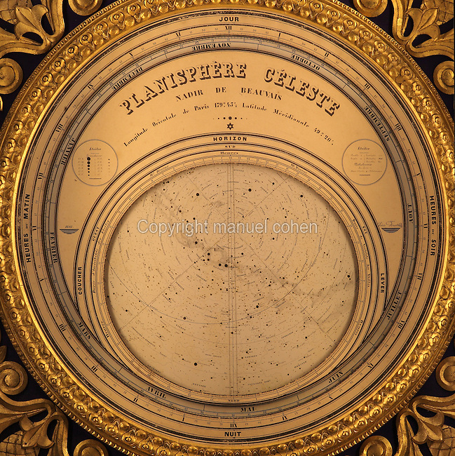 Celestial map of the Southern hemisphere on the side of the Astronomical Clock, built 1865-68 by clockmaker Auguste Verite, based on a model of the Strasbourg clock, in the Cathedrale Saint-Pierre de Beauvais or Cathedral of St Peter of Beauvais, an incomplete Gothic Roman Catholic cathedral consecrated in 1272, Beauvais, Oise, Picardy, France. The 52 dials display the times of the rising and setting sun and moon, the position of the planets, the current time in 18 cities around the world, and the tidal times. The clock also displays the epact (age of the moon in days on January 1) and the golden number. The cathedral itself consists only of a transept built in the 16th century and choir, with apse and 7 polygonal apsidal chapels from the 13th century. It was listed as a historic monument in 1840. Picture by Manuel Cohen