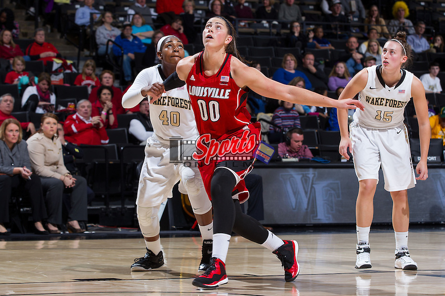Sara Hammond (00) of the Louisville Cardinals boxes out Nicole Floyd (40) of the Wake Forest Demon Deacons during second half action at the LJVM Coliseum on January 11, 2015 in Winston-Salem, North Carolina.  The Cardinals defeated the Demon Deacons 79-68.  (Brian Westerholt/Sports On Film)